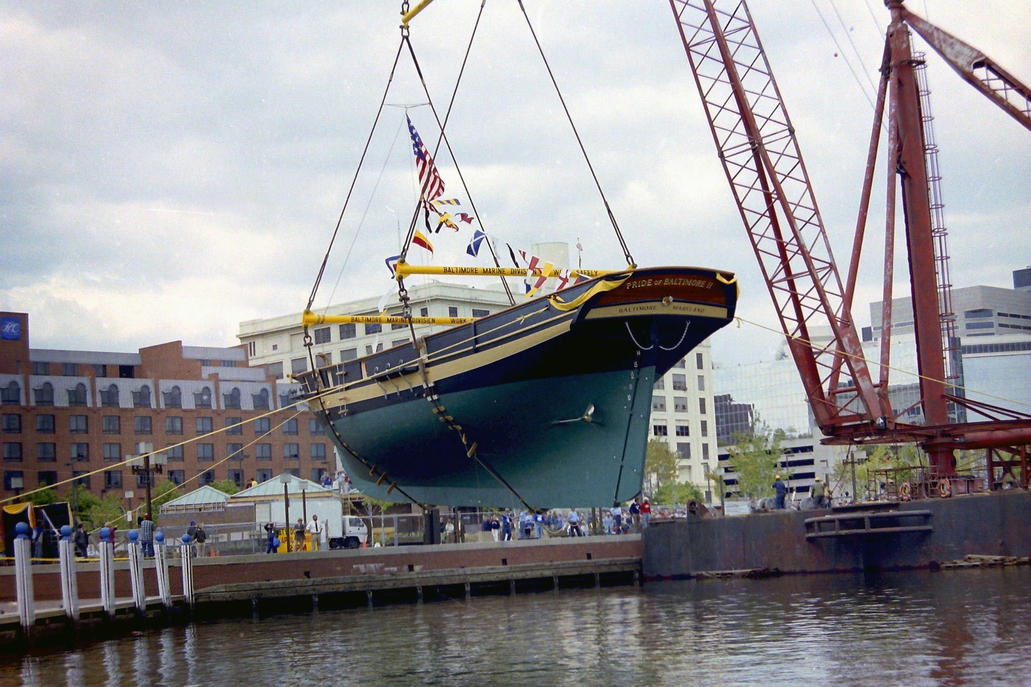 <em>Pride II</em> is lowered into the Inner Harbor. Courtesy of Charles Bregger.
